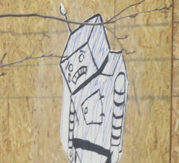 Graffiti of a sad robot with his head hanging down