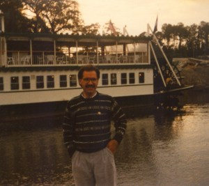 Photo of D.G. Brian Jones in front of the Southern Star paddle wheeler at the 1989 CHARM conference