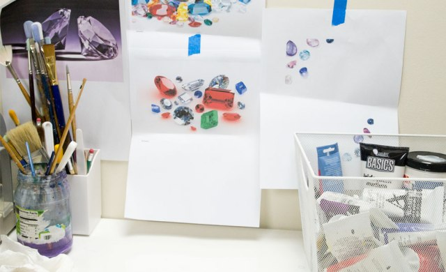 Inspiration images of gemstones taped to the wall, ready to be used as painting reference. A vital part of the painted wedding invitation process.