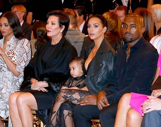North West sitting front row fashion show