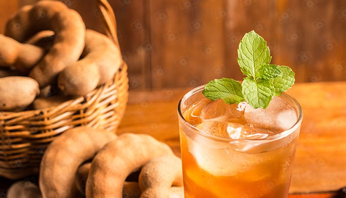 Copy space, Delicious sweet drink tamarind and ice with mint leaves