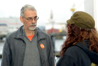 Michael talking with voter while campaigning on Friday morning at the sea bus terminal , April 7th, 2017