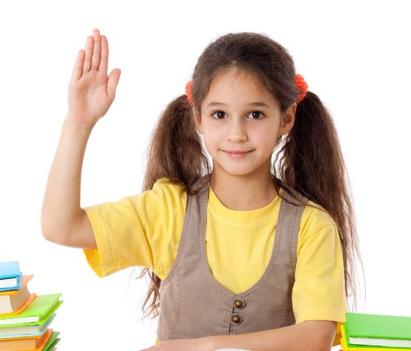 Girl with books and raises his hand up, isolated on white; Shutterstock ID 121770121; PO: aol; Job: production; Client: drone