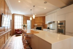 white bulthaup kitchen in panelled room