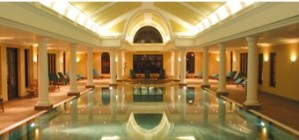 grand swimming pool with arched, lit ceiling