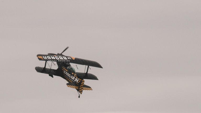 Hangar 24 bi-plane in cloudy skies