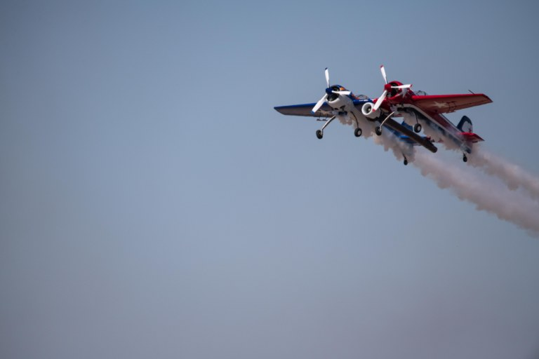 Yak 110 seemingly hanging in mid-air with smoke trails