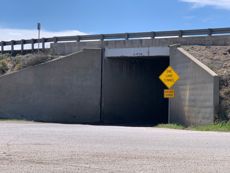A one lane underpass road.