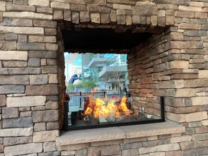 Fireplace at Pizza Republica. Blue bear statue in far background.
