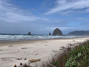 A view of Haystack Rock and the Needles from the parking lot at Tolovana Park.