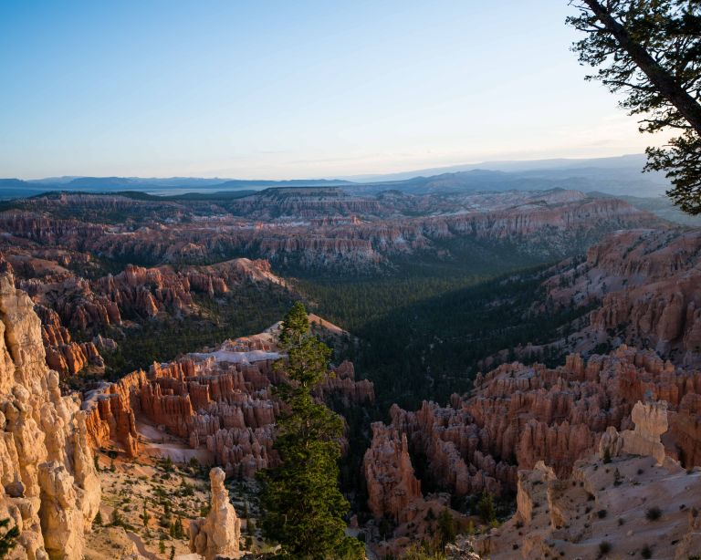 A slightly different view shows the intensity of the sunrise on the hoodoos.