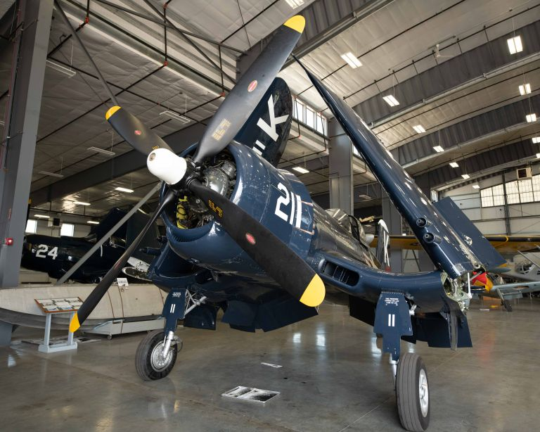 A Vought F4U Corsair plane from the side.