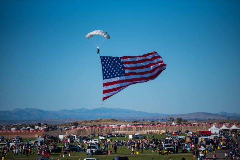 Skydiver coming in for a landing with the American flag.
