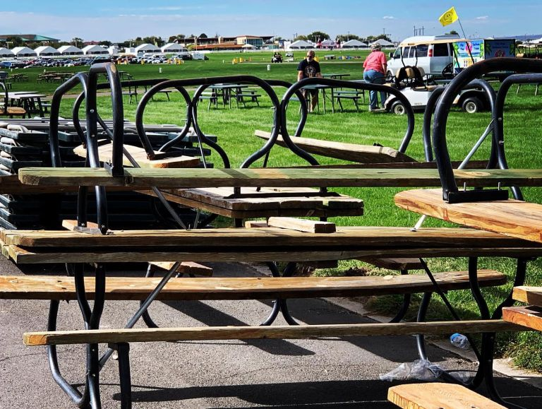 Some of the crew putting out the picnic tables at the edge of the Launch Field, close to many of the food vendors.