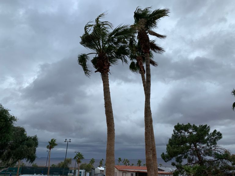 Rain bearing dark clouds and some 15-20 mph winds at 3:30 p.m.