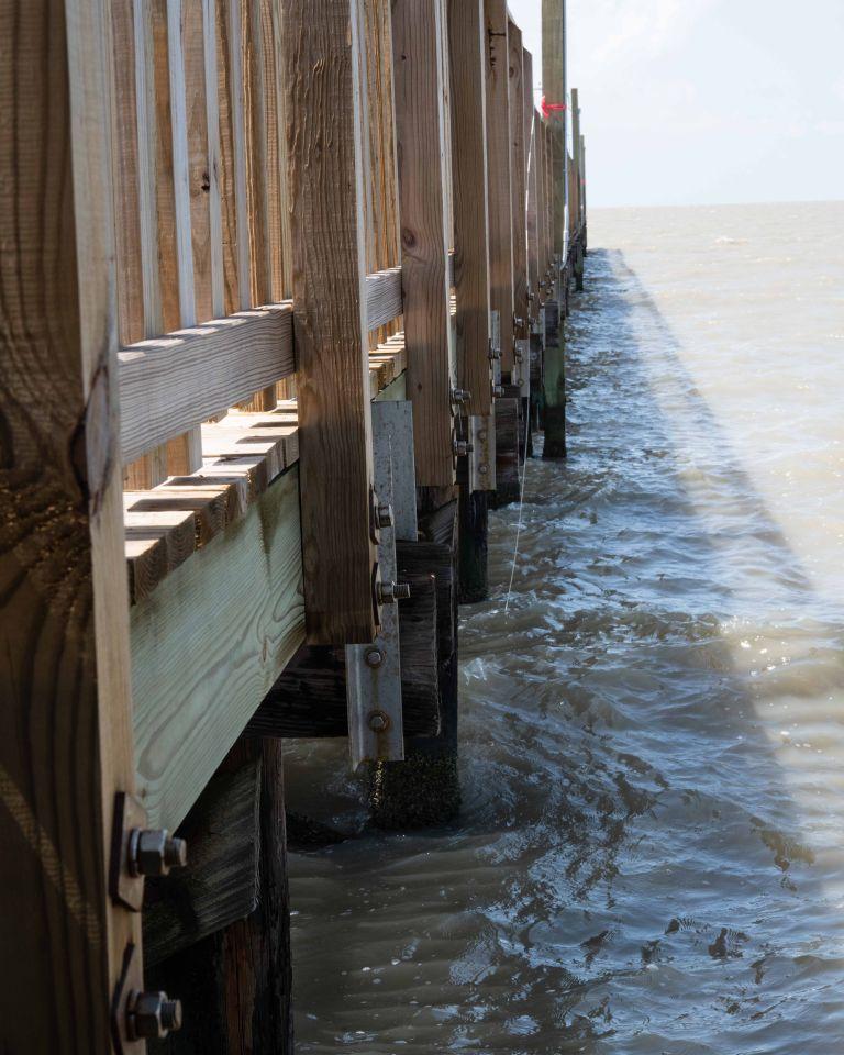 Wooden slats of fishing pier.