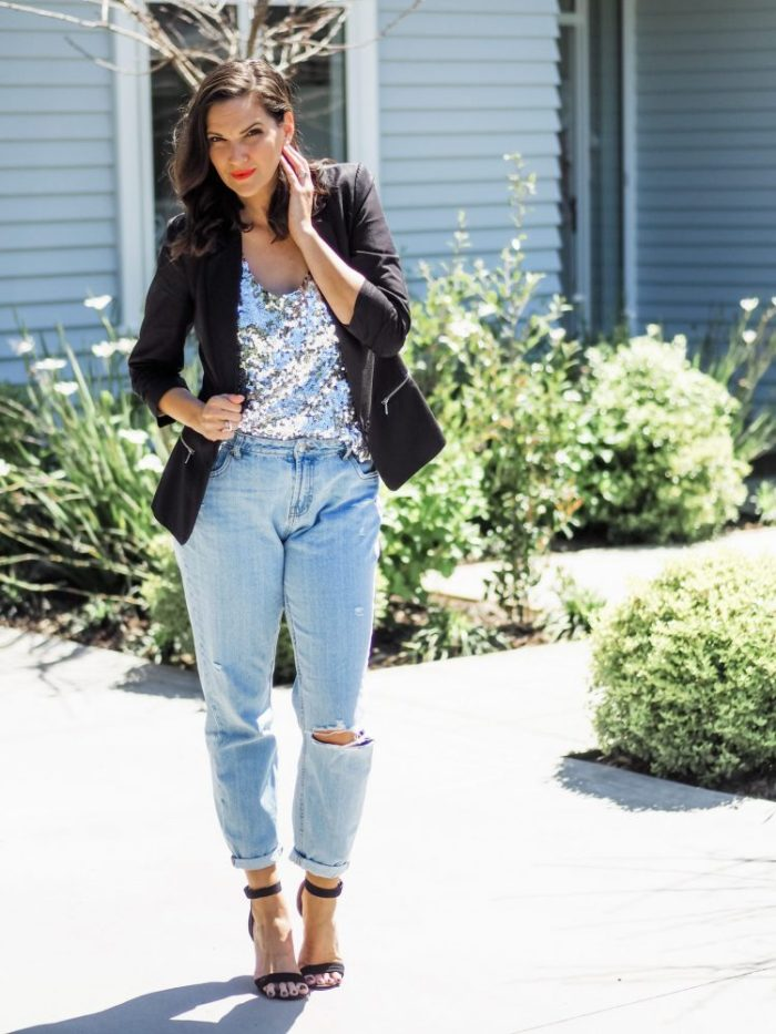 black blazer styled with a sequin camisole, mom jeans and black heels