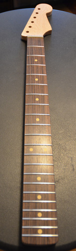 Rosewood fingerboard with aged clay dots