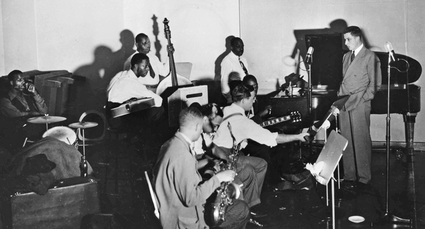 John Hammond at a recording session with Buck Clayton, Lester Young, Charlie Christian, Benny Goodman and Count Basie.