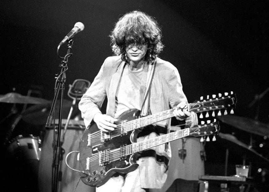 Jimmy Page playing a double-necked Gibson guitar
