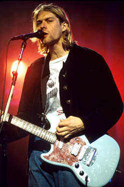 Kurt Cobain with his modified Fender Mustang