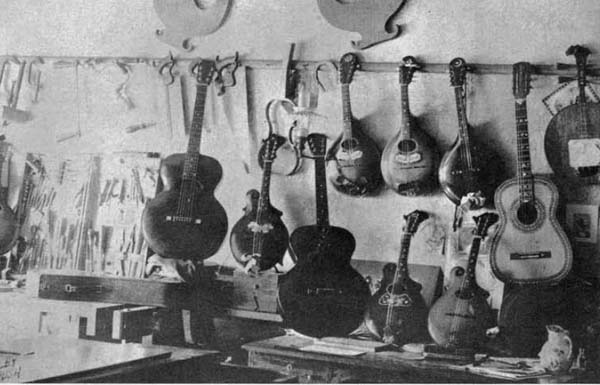 Orville Gibson's workbench in his one room workshop with some of his instruments