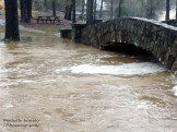 Normally this is just a creek with feet between the water and bridge.