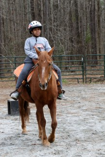 Tyler Patterson, a Boy Scout with Troop 69 out of Columbus, Ga., learns to ride a horse during a visit to The Warrior Outreach Ranch. Warrior Outreach Ranch is a nonprofit organization for veterans and family members to relax and unwind through equine therapy. (U.S. Army Reserve Photo by Maj. Michelle Lunato/released)