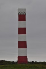 A view of the red and white tower called Gribben Head