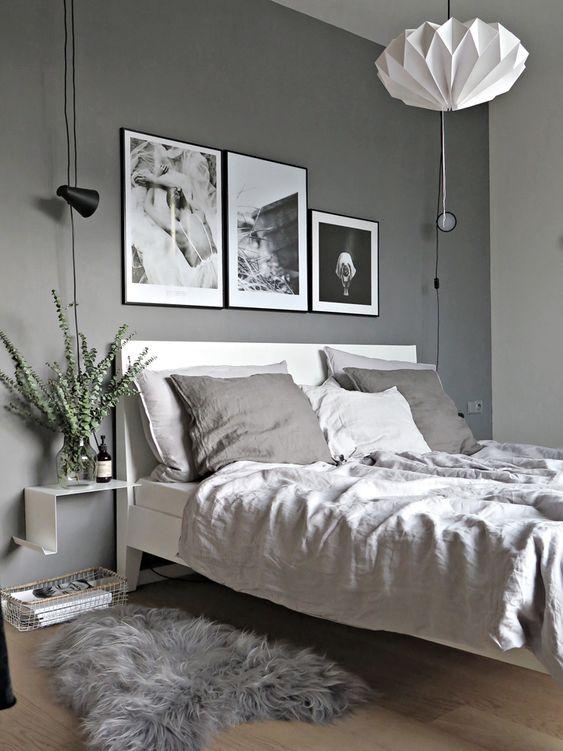 camera da letto con parete color grigio