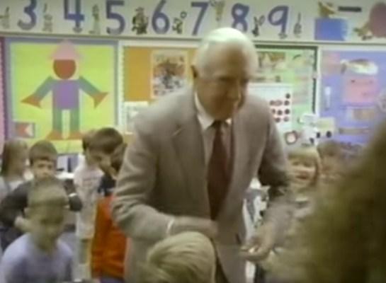 Walter Cronkite dancing with schoolchildren