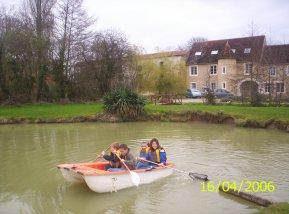Row a boat around a pond