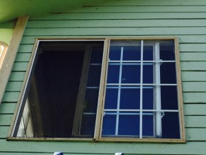 Existing wood window with metal fin