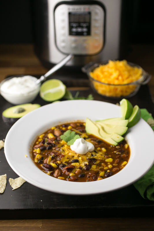 This vegetarian taco soup is healthy and delicious, and it's easy to make in either your slow cooker or your Instant Pot! | recipe from Chattavore.com
