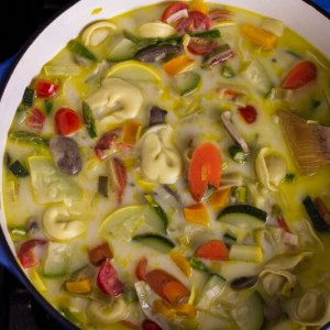 Tortellini primavera soup is creamy and chock full of fresh spring vegetables and cheesy tortellini! From #Chattavore
