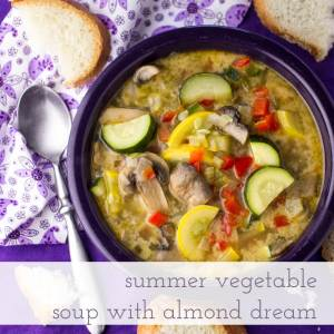 This summer vegetable soup is light but filling, full of fresh vegetables, and just a little creamy, thanks to the addition of DREAM Ultimate Almond!   recipe from Chattavore.com