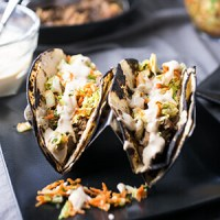 These Asian pork tacos are made with tender pork shoulder & light, delicious slaw & come together so quickly in the pressure cooker or Instant Pot! | recipe from Chattavore.com
