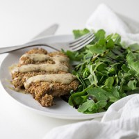 Coated in crunchy sesame sticks and baked on a sheet pan, this sesame crusted chicken is simple and so flavorful served with creamy apricot mustard! | recipe from Chattavore.com