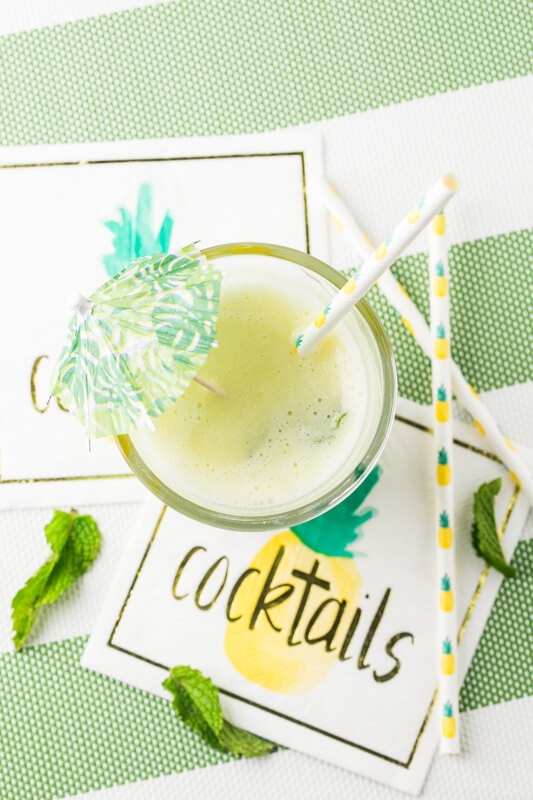 A frozen pineapple mojito just tastes like summer! It's a great way to cool off on a hot day and a delicious way to kick back and relax! | Recipe from Chattavore.com