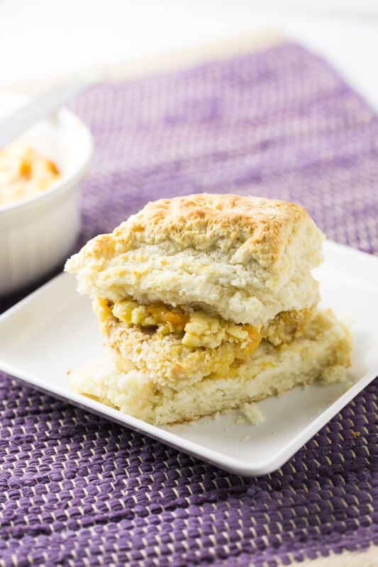 This oven-fried chicken biscuit with peach-honey butter is sure to satisfy your deepest Southern breakfast sandwich cravings! | Recipe from Chattavore.com