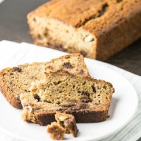 Banana beer bread with chocolate chips is a delicious and simple to make bread that is just sweet enough for dessert but you can eat it for breakfast too! | Recipe from Chattavore.com