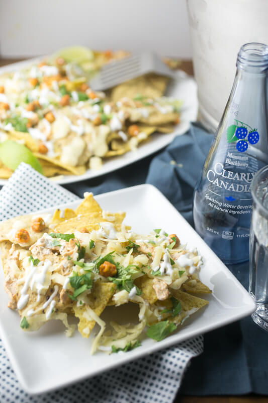 There's nothing quite a like a huge platter of cheesy nachos to satisfy everyone's tastebuds on game day! These Sriracha-ranch chicken nachos check off all of the flavor boxes! #sponsored #worldmarkettribe #gameday #nachos | Recipe from Chattavore.com