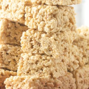 a close-up photograph of a stack of salted brown butter Rice Krispies treats