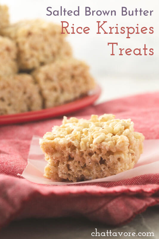 a photograph of a Rice Krispies treat plate a plate of Rice Krispies treats in the background
