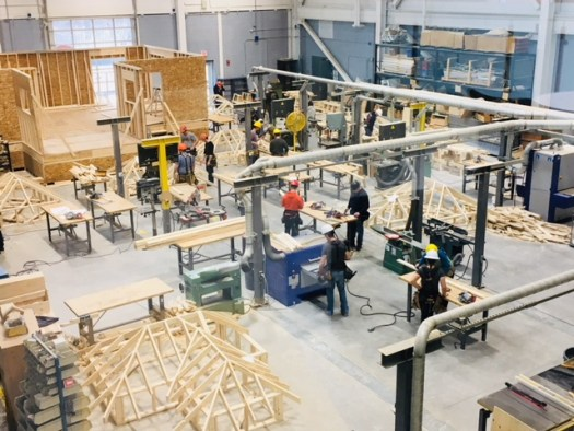Construction students build a mock house