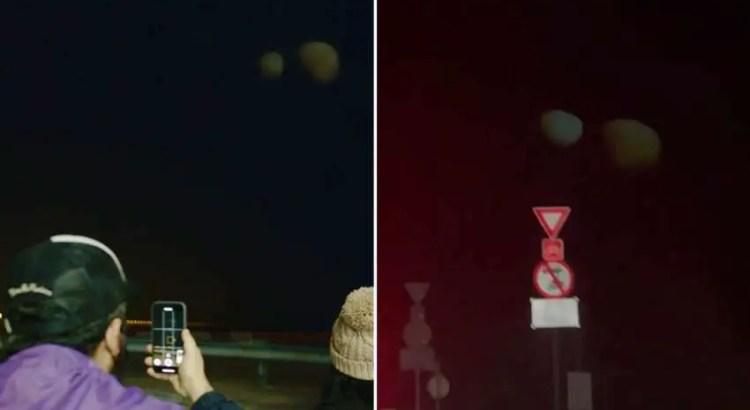 Dois estranhos e enormes objetos aparecem no céu noturno, muito parecidos com planetas.