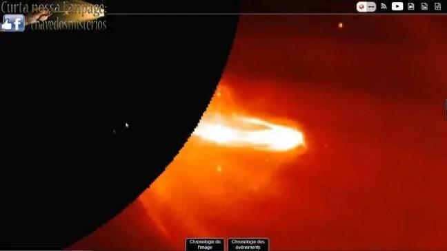 Sonda espacial SOHO fotografa uma nave espacial enorme usando o sol como portal estelar.
