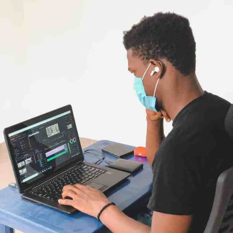 man in black crew neck t shirt using black laptop computer