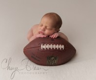newborn baby on football