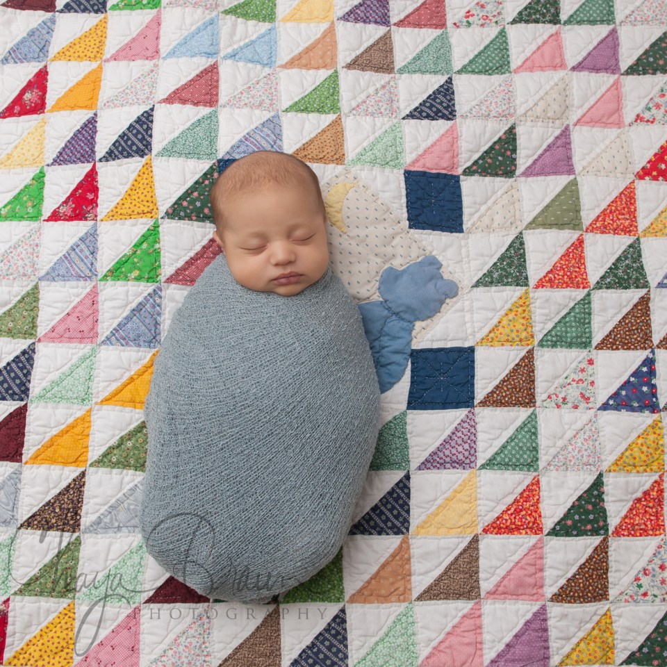 newborn baby boy on heirloom blanket